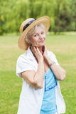 Best ager women outoors with hat royalty free stock photo