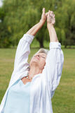 Best ager women practising yoga ant tai chi Stock Photography