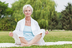 Best ager women practising yoga ant tai chi Stock Images