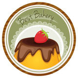A best bakery label with a cake and a strawberry Royalty Free Stock Image