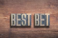 Best bet wood. Best bet phrase combined on vintage varnished wooden surface royalty free stock image