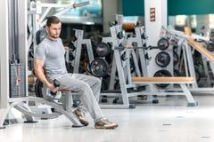 Best body. Smiling athlete bodybuilder man at biceps brachii mus Royalty Free Stock Image