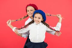 Best braided hairdo. Small girls being proud of long braid hairdo on pink background. Little kids holding plait hairdo. Children need new hairdo in hair salon royalty free stock photos