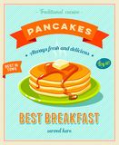 Best breakfast - vintage restaurant sign. Retro styled poster with pile of best in town pancakes with butter and maple syrup. Stock Photos
