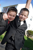 Best Buddies. Two happy young boys dressed in suits with smiles on their faces Stock Image