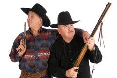 Best buddies. Best buddies wearing cowboy clothes, posing with guns Stock Photo
