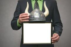 Bull stock broker. Bull market concept. Best bull stock broker. Diploma template of best player for raising stock prices on the exchange. Businessman holding Royalty Free Stock Photography