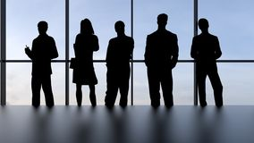 Best business team. Group of silhouette people standing against the window Royalty Free Stock Images