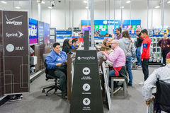 Best Buy during Black Friday 2014. People at Best Buy Mobile section purchasing new phones on Black Friday Royalty Free Stock Photos