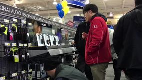 Best buy's black Friday sale with shopper finding audio headphones to buy stock footage