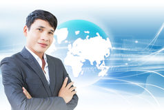 The Best CEO. Smart Asian Businessman With High technology Background Royalty Free Stock Image