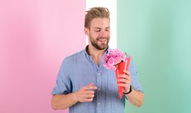 Best choice. Man ready for date bring pink flowers. Boyfriend smiling holds bouquet waiting for date. Macho holds. Bouquet as romantic gift. Guy bring romantic stock image