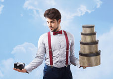 Best choice for present, concept. Handsome man choosing the present, concept Royalty Free Stock Photography