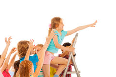 Best in class girl climb up other pull down Stock Photo