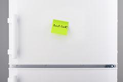 Best cook note on green sticky paper on white refrigerator Royalty Free Stock Image