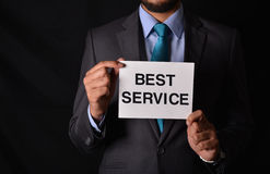 Best Customer Service - professional holding sign in hands Royalty Free Stock Photo