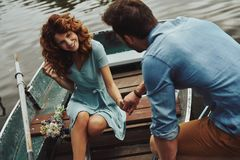 Best date ever. Happy young couple getting ready to row a boat while enjoying their date outdoors royalty free stock photo