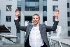 The best day ever Full length of happy young businessman in formal wear keeping arms raised and expressing positivity while standi Stock Photos