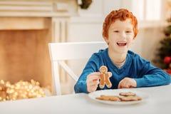 Beaming ginger boy enjoying christmas morning Stock Photography