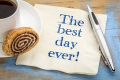 The best day ever!. Positive handwriting on a napkin with a cup of coffee stock photography
