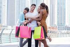 Best day for a friend go shopping. Beautiful girls in dresses hu Royalty Free Stock Image
