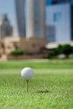 The best day for golfing. Golf ball is on the tee for a golf bal Royalty Free Stock Photo