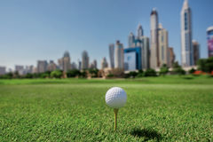 The best day for golfing. Golf ball is on the tee for a golf bal Stock Image
