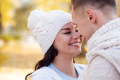 This is the best day in my life. Attractive young men and women are flirting in the autumn park. They are embracing and smiling. The loving couple is standing royalty free stock photography
