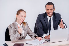 Best day to work together. Two smiling businessman looking at ea Stock Photography
