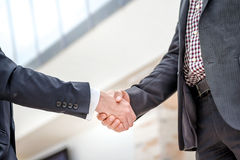 Best Deal! Two young businessman standing opposite each other an Royalty Free Stock Photography