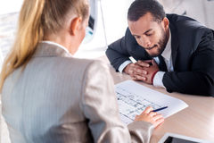 The best design solutions. Successful African businessman consid Stock Images