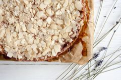 Curd pie with raspberry jam and almonds. Best dessert: Curd pie with raspberry jam and almonds Stock Photos