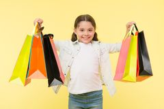 Best discounts and promo codes. Back to school season great time to teach budgeting basics children. Girl carries. Shopping bags. Prepare for school season buy royalty free stock photos