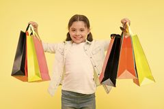 Best discounts and promo codes. Back to school season great time to teach budgeting basics children. Girl carries. Shopping bags. Prepare for school season buy royalty free stock photo