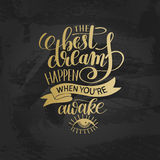 The best dreams happen when you`re awake hand written lettering. The best dreams happen when you`re awake gold hand written lettering positive motivation quote Royalty Free Stock Photo