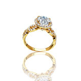 The best engagement ring. Gold ring with a diamond. The symbol of betrothal and marriage Royalty Free Stock Photo