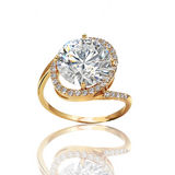 The best engagement ring. Gold ring with a diamond. The symbol of betrothal and marriage Royalty Free Stock Images