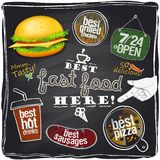 Best fast food here, chalkboard background. stock illustration
