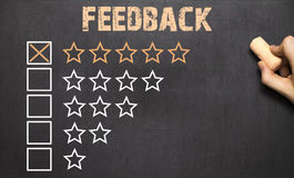Best feedback five golden stars.Chalkboard. Best feedback five golden stars on Chalkboard Stock Photos