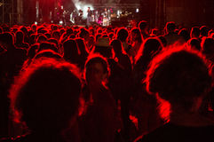Best Fest festival. Red lighted people silhouettes in front of a stage at Best Fest music festival, Romania stock image