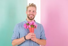 Best flowers for her. Macho holds bouquet as romantic gift. Guy bring romantic pleasant gift waiting for her. Man ready. For date bring pink flowers. Boyfriend stock photography