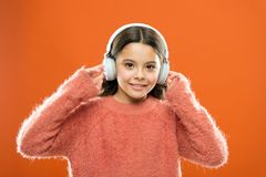 Best free music apps for your mobile device. Enjoy sound. Girl cute little child wear headphones listen music. Kid stock photos