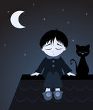 Best friend. Sad boy in pyjamas sitting on top of roof with his black cat Stock Images