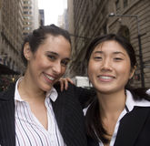 Best Friend Business Woman. Multi-ethnic business women and best friends pose outside in an urban environment royalty free stock image