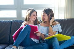Best friend girls studying homework at home royalty free stock images