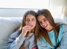Best friend girls watching TV cinema best friend girls watching. Best friend girls portrait watching TV cinema at home with popcorn Royalty Free Stock Photo