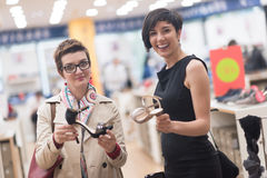 Best friend shopping in big mall Royalty Free Stock Images