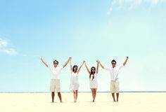 Best friend in white together holding and raise each other hand. Portrait of best friend in white together holding and raise each other hand Royalty Free Stock Photo