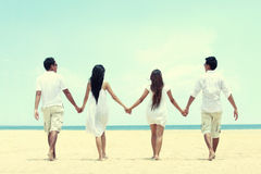 Best friend in white walking together holding each other hand Royalty Free Stock Photos