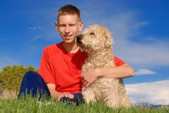 Best friends. Teenager and his dog are the best friends Stock Photo